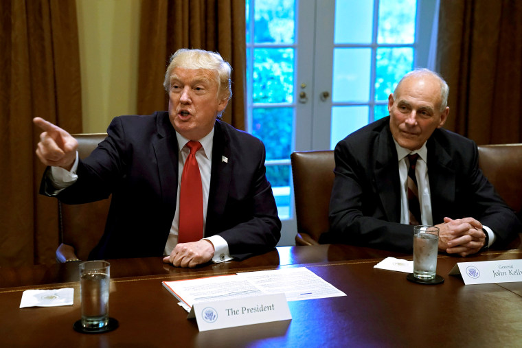 Image: FILE PHOTO: U.S. President Donald Trump gestures next to White House Chief of Staff John Kelly during a briefing at the White House in Washington