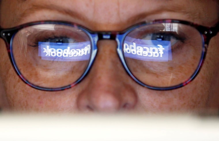 Image: FILE PHOTO: The Facebook logo is reflected on a woman's glasses in this photo illustration