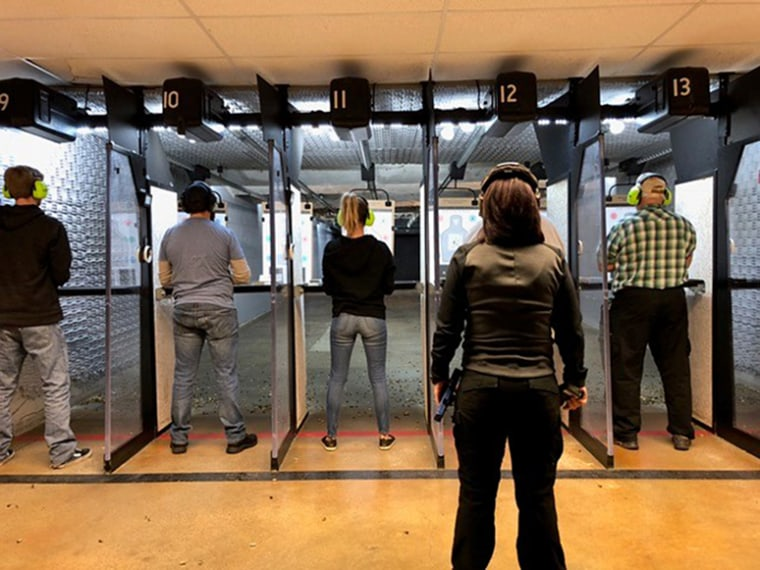 An instructor at Bristlecone Shooting, Training and Retail Center in Denver teaches a recent concealed-carry course in which students learn how to safely discharge firearms in self-defense.