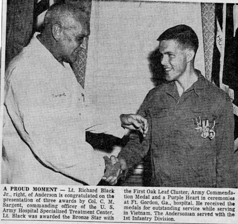 A newspaper clipping of Lt. Richard Black being awarded the bronze star.