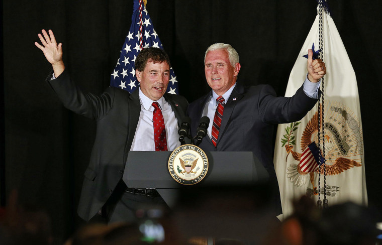 Vice President Mike Pence waves to the crowd with 12th Congressional District Republican candidate Troy Balderson during a rally Monday in Newark, Ohio.