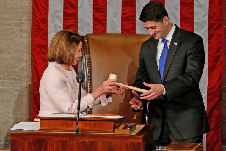 U.S. House Speaker Ryan receives the gavel from House Democratic Leader Pelosi during opening session of the new Congress on Capitol Hill in Washington