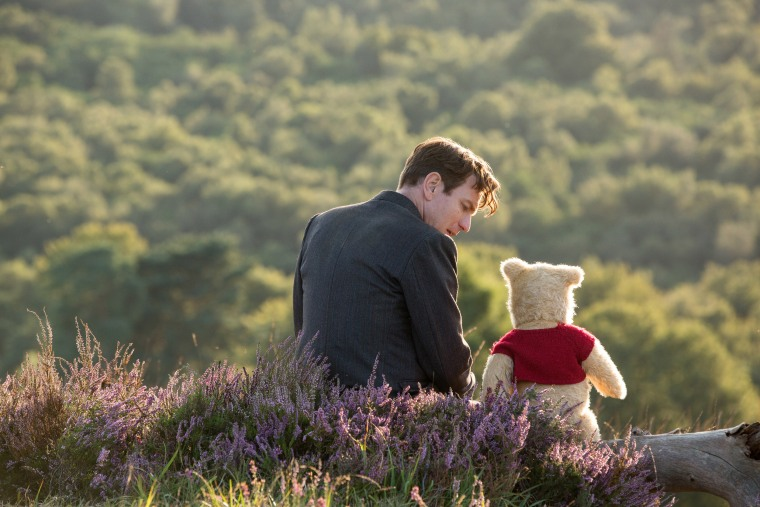 Christopher Robin. (Ewan McGregor) with his long time friend Winnie the Pooh in Disney's live-action adventure Christopher Robin