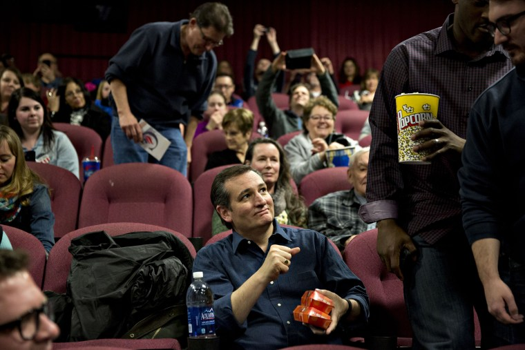 "Ted Cruz takes his seat during a campaign event at a showing of the film ""God's Not Dead 2"""