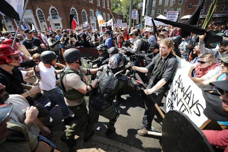 """Image: Protesters clash as the \""""Unite the Right\"""" rally in Charlottesville"""