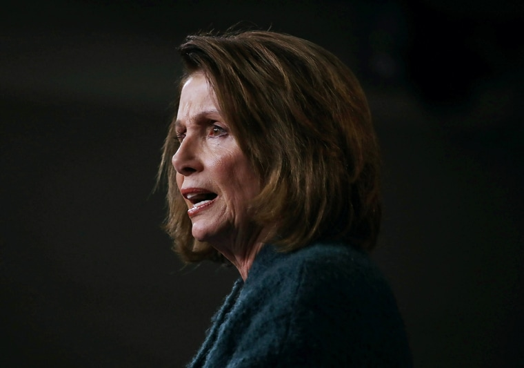 Image: Pelosi speaks about the Republican tax reform legislation