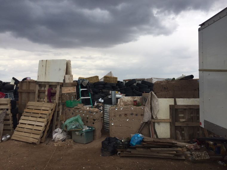 A makeshift compound in Amalia, New Mexico, harbored five adults and 11 children