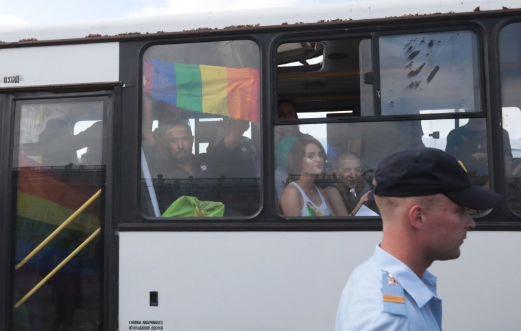 Image: Demonstrators are seen in a police bus after being detained during the LGBT community rally in central St. Petersburg