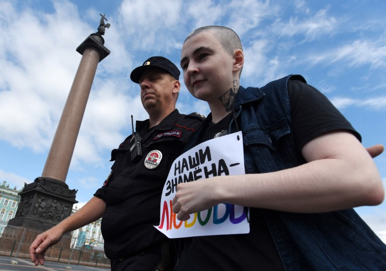 Police detain an LGBT activist during an unauthorized rally at the 9th St. Petersburg Pride Parade on Palace Square.