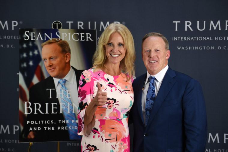 Trump adviser Kellyanne Conway poses with former White House press secretary Sean Spicer