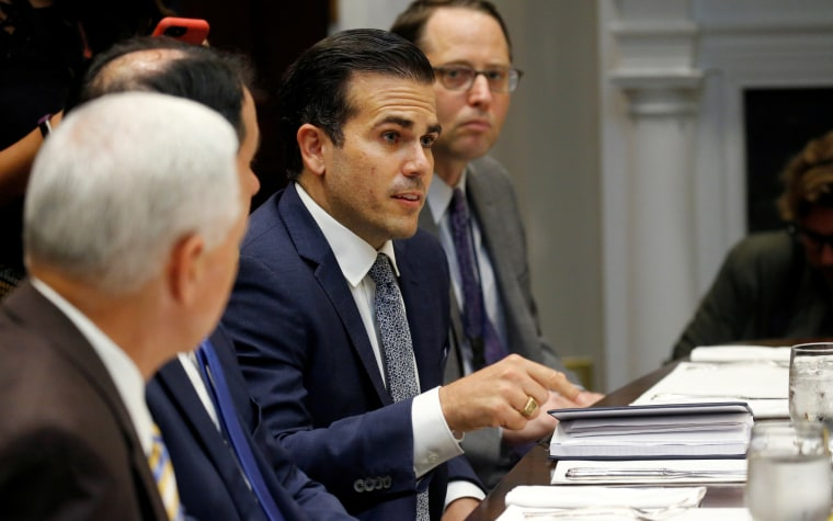 Puerto Rico Governor Ricardo Rossello speaks to U.S. President Donald Trump during a working lunch with governors in the Roosevelt Room at the White House in Washington, U.S.