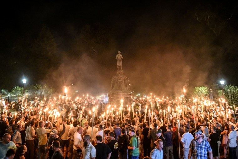 Image: White nationalists participate in a torch-lit march on the grounds of the University of Virginia ahead of the Unite the Right Rally in Charlottesville, Virginia