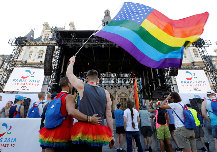 Image: People attend the inauguration of the Gay Games village at the Hotel de Ville city hall in Paris