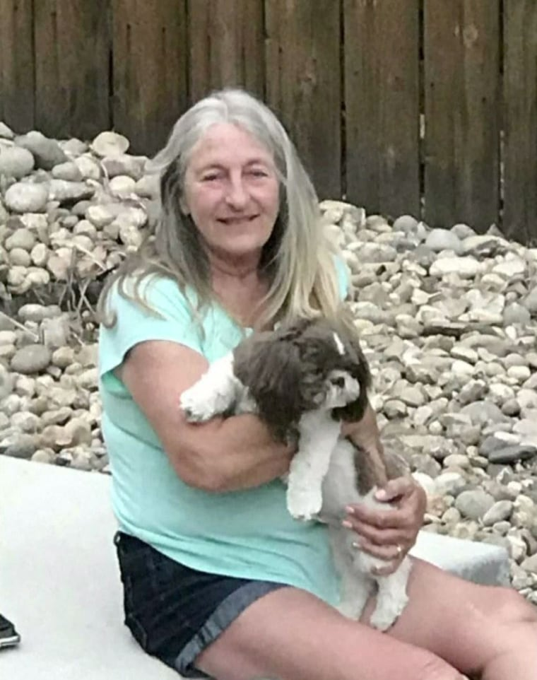 Sharon Larson and her dog Beau.