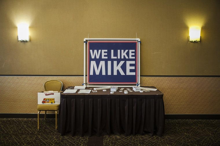 Image: Signs for Rep. Mike Capuano at a campaign event with the local carpenter's union in Somerville