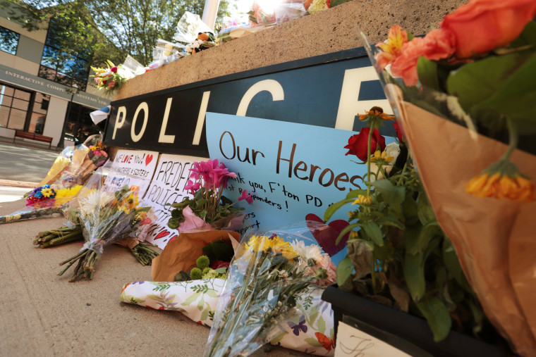 Image: A makeshift memorial has been forming outside Fredericton Police Headquarters in Fredericton
