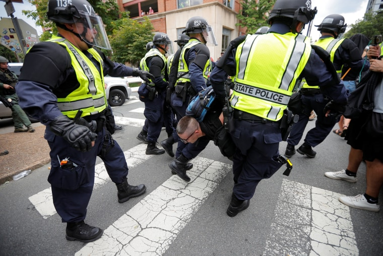Image: Police carry a protester at the site where Heather Heyer was killedin Charlottesville