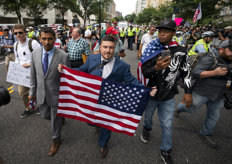 Image: Jason Kessler, center, and members of the alt-right march to the White House