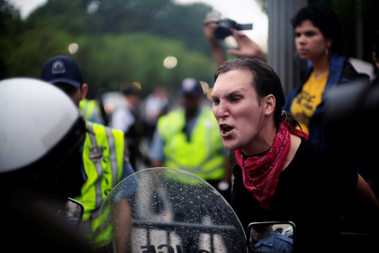 Image: Nadelyn King of Richmond, Virginia, shouts at police officers guarding the White House on Pennsylvania Avenue in Washington