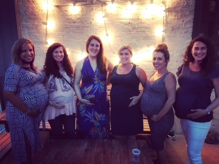 """Lewis refers to her exercise class friends as her """"mommy friends,"""" and says they talk about everything from postpartum depression to teething."""