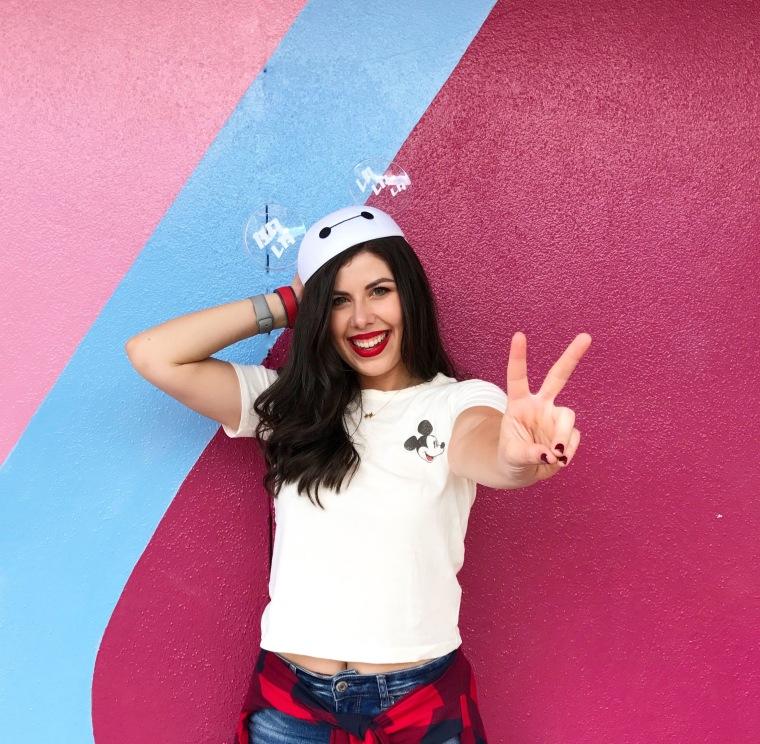 Jill Kaplan of Disney Girl Beauty poses at Epcot's Bubblegum Wall.