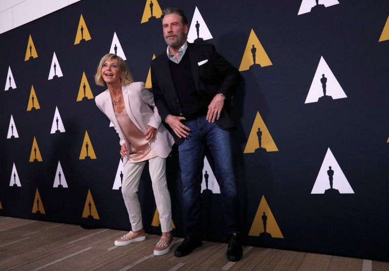 "Image: Cast members Travolta and Newton-John dance at a 40th anniversary screening of ""Grease"" at the Academy of Motion Picture Arts and Sciences in Beverly Hills"