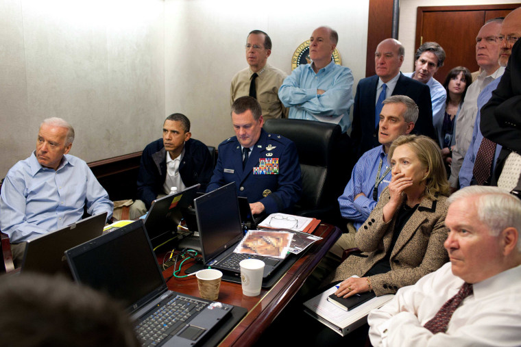 Then Secretary of State Hillary Rodham Clinton, President Barack Obama and Vice President Joe Biden, along with with members of the national security team, receive an update on the mission against Osama bin Laden in the Situation Room of the White House in Washington.