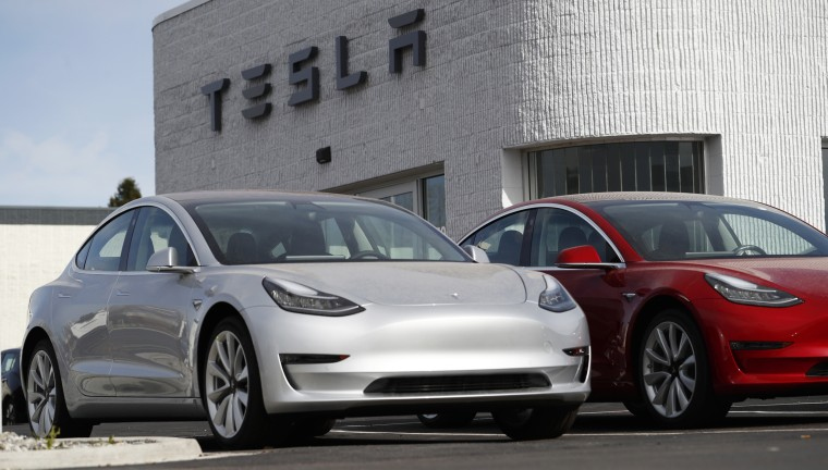 Image: Unsold 2018 Model 3 Long Range vehicles sit on a Tesla dealer's lot