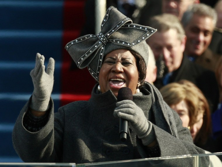 Image: Aretha Franklin signs during the inauguration ceremony for President-elect Barack Obama in Washington