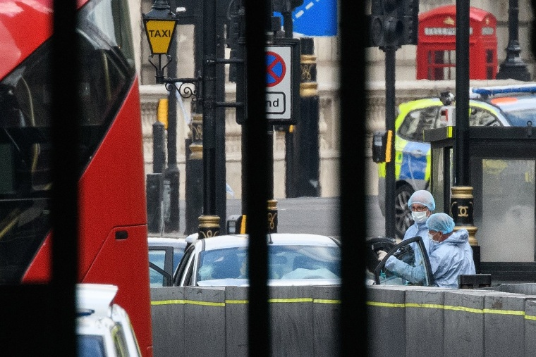 Image: Forensic teams investigate at the scene of a crash in London