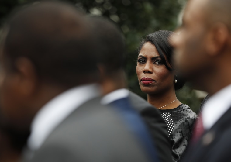 Omarosa Manigault stands with the of leaders of Historically Black Colleges and Universities
