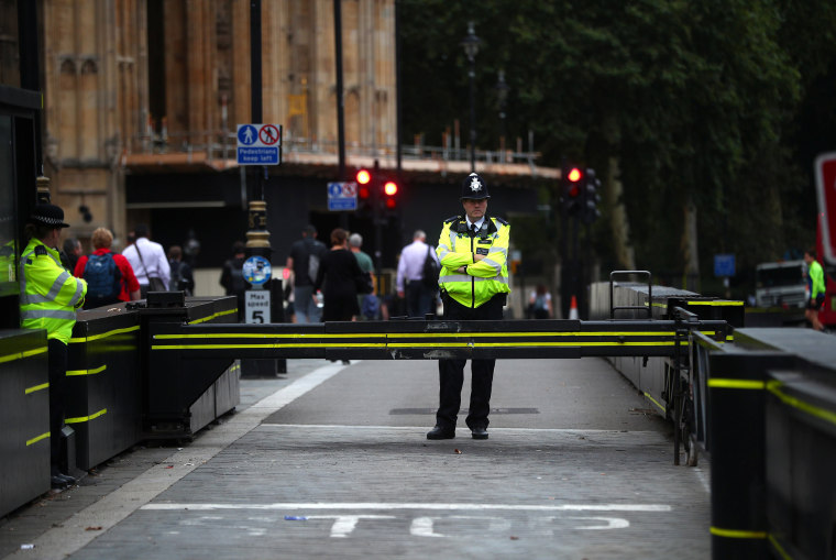 Image: Police officers stand at the vehicle barrier to the Houses of Parliament where a car crashed after knocking down cyclists and pedestrians yesterday in Westminster, London