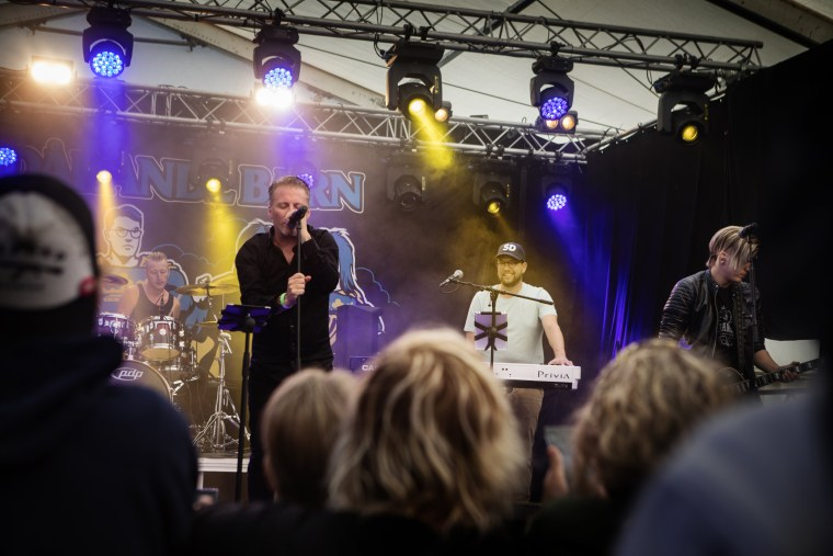 Image: Jimmie Åkesson plays keyboards in his band at the festival