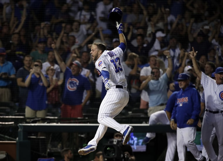 Image: Chicago Cubs' David Bote reacts as he rounds the bases after hitting the game-winning grand slam