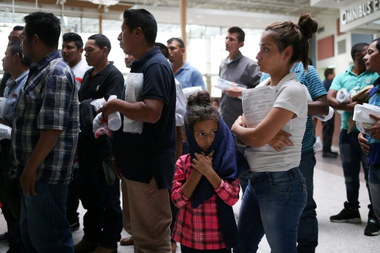 Image: Undocumented immigrant families are released from detention at a bus depot in McAllen