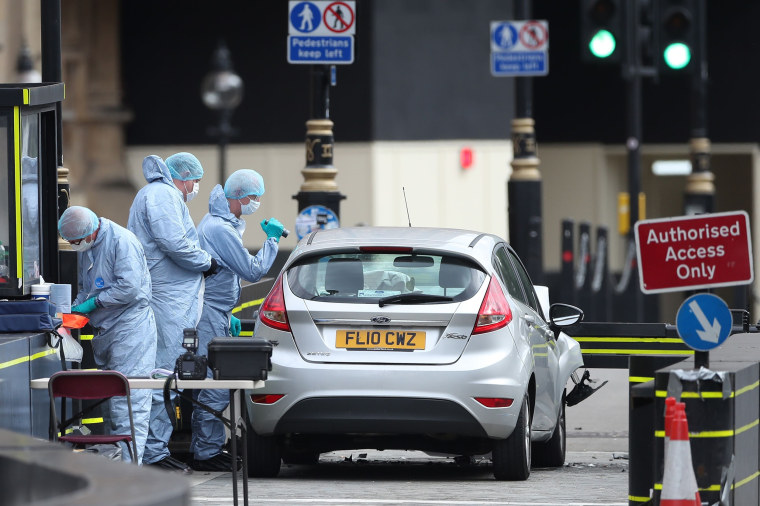 Image: Police forensics officers work around a silver Ford Fiesta car that was driven into a barrier at the Houses of Parliament