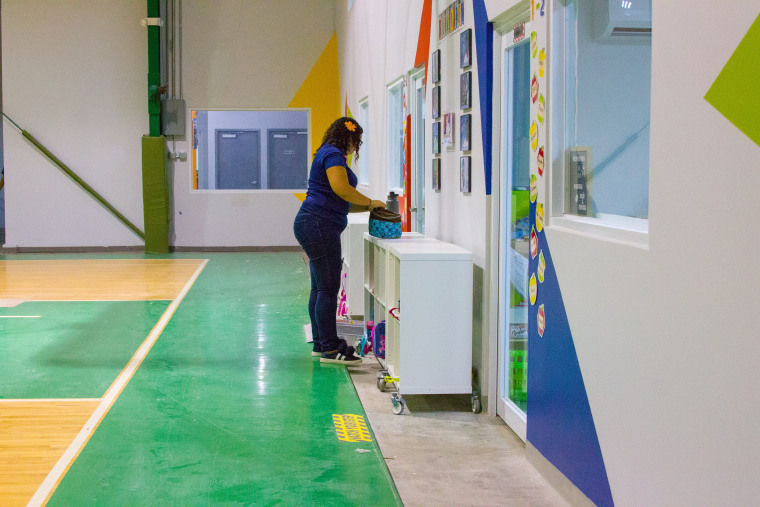 A teacher organizes her student's 'cubbies' at Vimenti, Puerto Rico's first charter school, during orientation week.