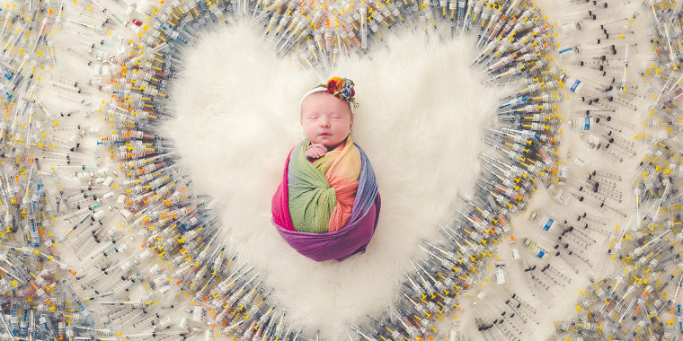 Arizona couple that documented their pregnancy struggles with this amazing photo shoot showing the 1660 syringes that the mom took to get there.