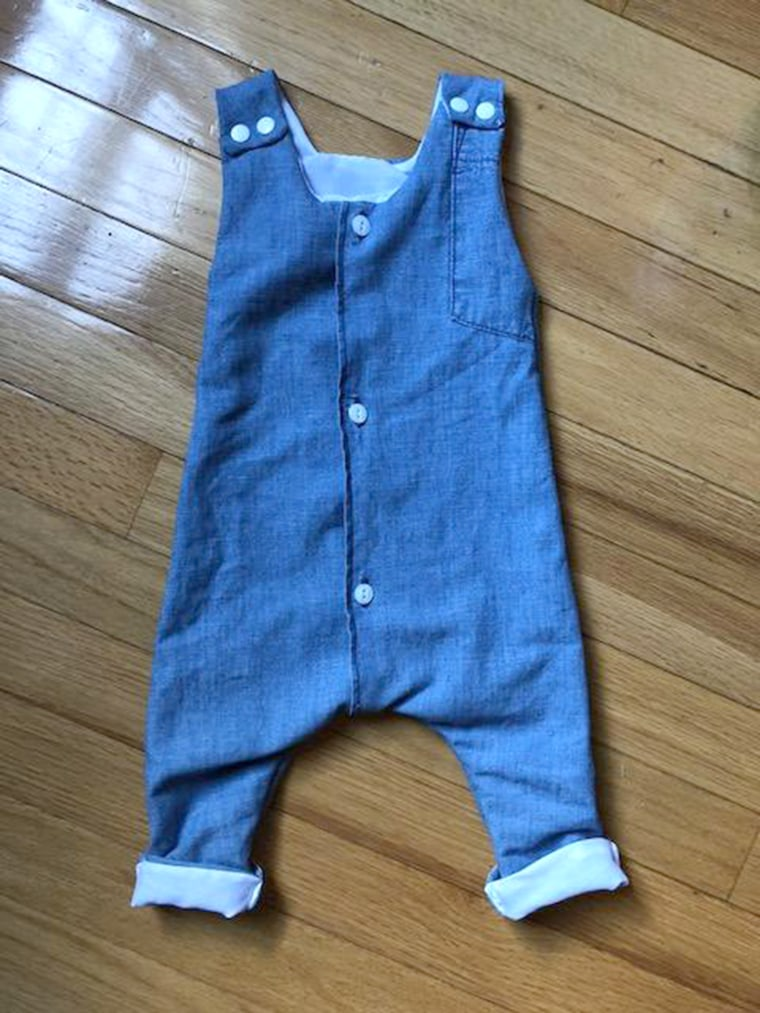Mom makes repurposed baby clothes from dad's old shirts.