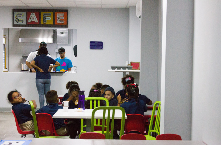 Kids have lunch at the cafeteria in Vimenti, Puerto Rico's first charter school, during orientation week.