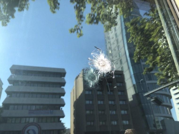 Image: A bullet mark is seen outside the U.S. Embassy in Ankara, Turkey