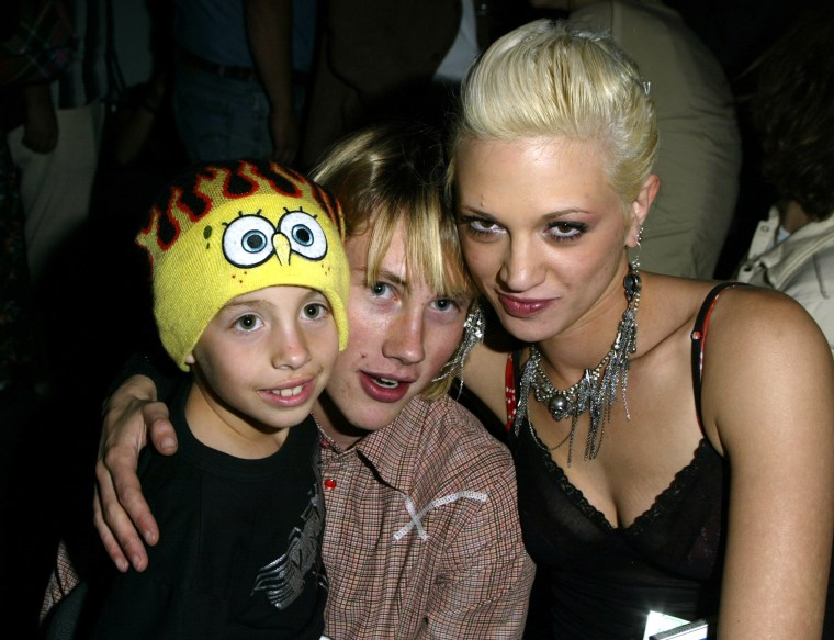 Jimmy Bennett, John Robinson and Asia Argento.