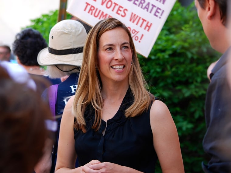 Mikie Sherrill joins protesters outside of U.S. Rep. Rodney Frelinghuysen's office in Morristown, New Jersey, in 2017. Sherrill, a former Navy helicopter pilot and federal prosecutor, is looking to capture a GOP congressional seat in New Jersey.