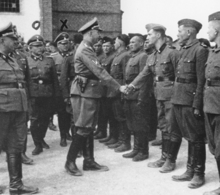 Heinrich Himmler, center left, shaking hands with new guard recruits at the Trawniki concentration camp in Nazi occupied Poland