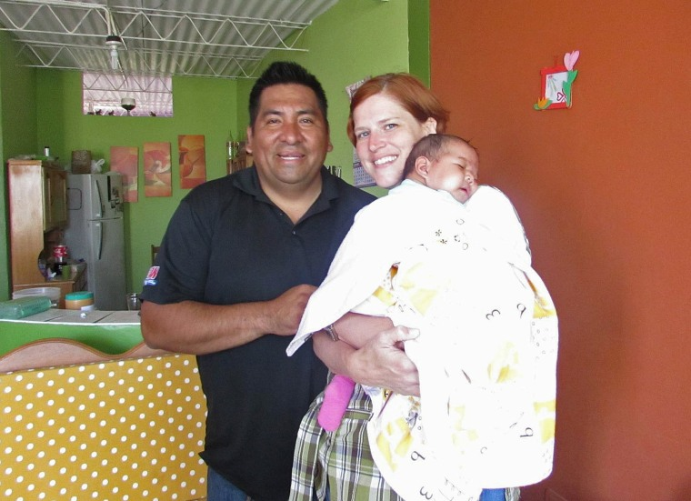 Amy and Marco Becerra care for infant Angela while in Peru.