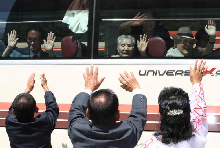 Image: North Koreans bid farewell to their South Korean family members as they leave after a reunion at Mount Kumgang resort