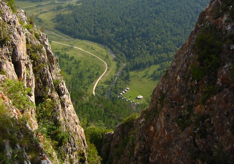 Image: View of the valley from above the Denisova Cave archaeological site in Russia.