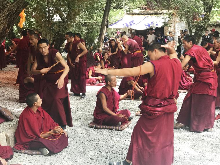 Image: Monks at Tibet's Sera Monastery debate Buddhist teachings