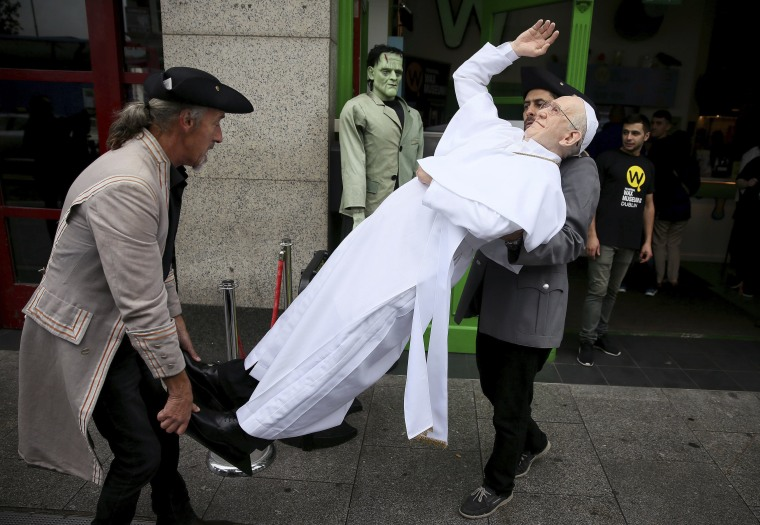 Image: A newly unveiled waxwork of Pope Francis is carried in Dublin