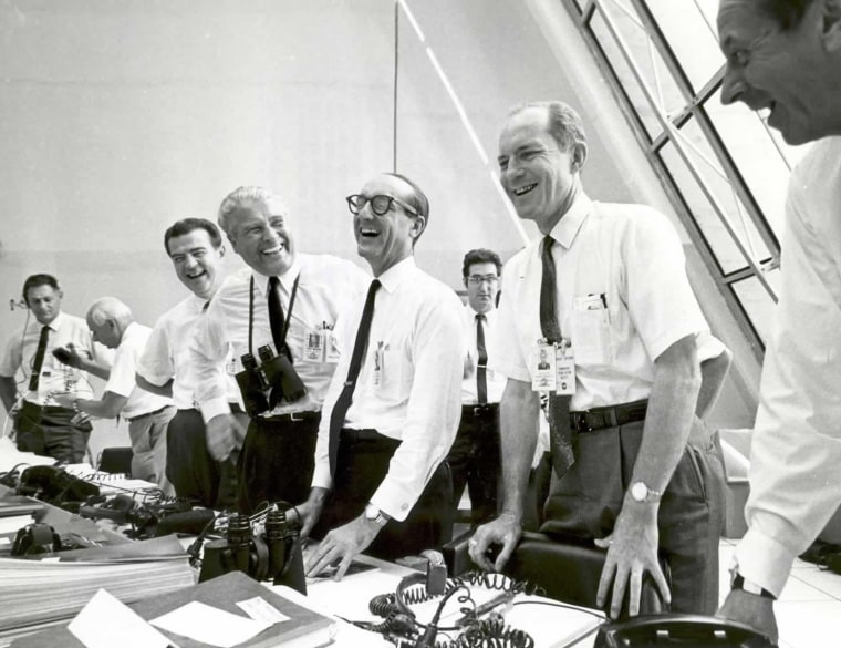 Image: Apollo 11 mission officials relax in the Launch Control Center following the successful Apollo 11 liftoff